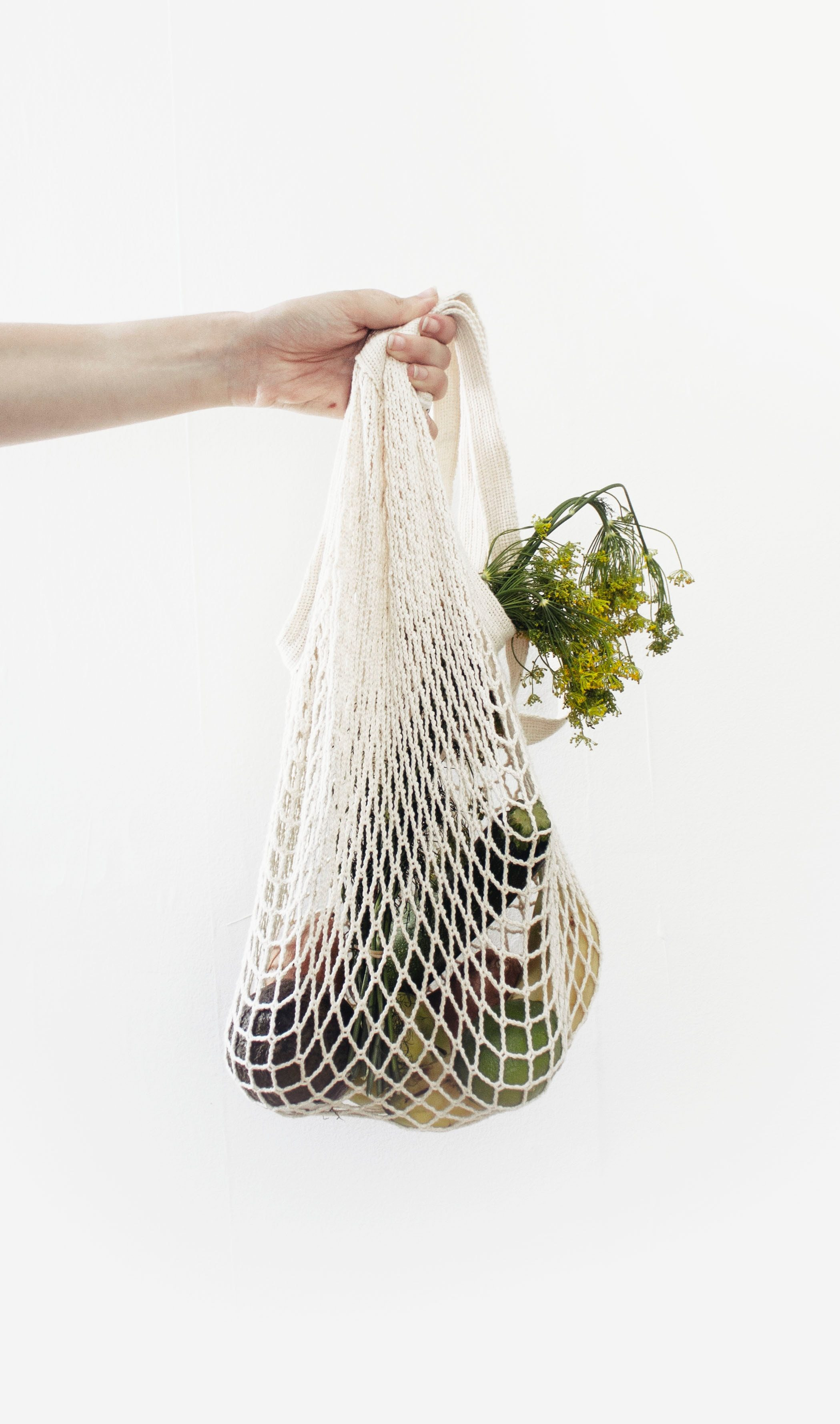 someone-holding-a-reusable-bag-with-